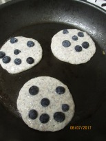 Smiley-faced gluten free pancakes