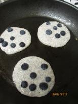 Smiley-faced gluten free pancakes
